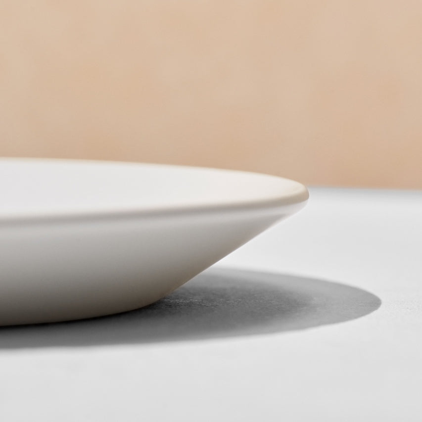 Close up of angled rim of dinner plate