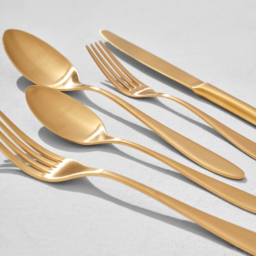 Close up of gold flatware pieces