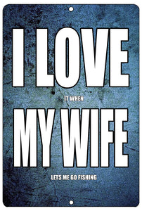 "blue funny metal sign with white writing that says ""I love it when my wife lets me go fishing,"" with the words ""I love my wife"" in larger letters"