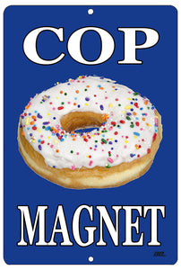 "blue funny metal sign with a sprinkled donut that says ""cop magnet"" in white writing"