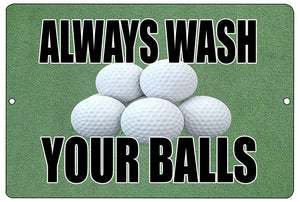 An image of a green aluminum sign with five golf balls in the middle and black lettering