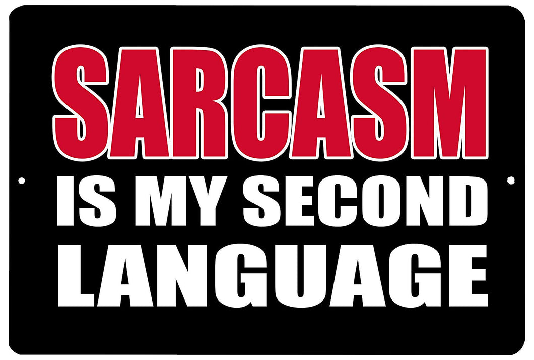 "An image of a black funny metal sign from Nuddamakers that says ""sarcasm is my second language"" in red and white writing."