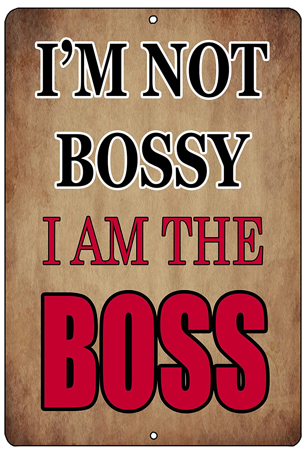 "An image of a brown funny metal sign from Nuddamakers that says ""I'm not Bossy, I am the Boss"" in black and red writing."