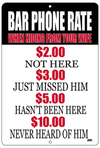 "An image of a white funny metal sign from Nuddamakers that says ""Bar phone rate when hiding from your wife: $2 not here, $3 just missed him, $5 hasn't been here, $10 never heard of him"" in white, black, and red writing."