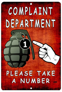 "An image of a red and orange funny metal sign with a picture of a grenade and the number one on the pin that says ""Complaint Department: please take a number"" from Nuddamakers."