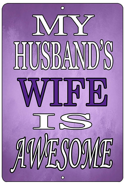 "An image of a purple funny metal sign from Nuddamakers that says ""My husband's wife is awesome"" in white and purple lettering."