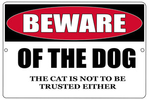 "black, red, and white funny metal sign that says ""beware of the dog. The cat is not to be trusted either."""