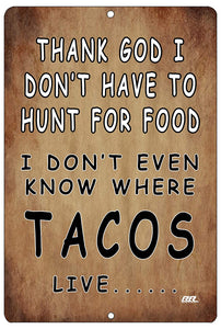"An image of a brown funny metal sign from Nuddamakers that says ""Thank God I don't have to hunt for food, I don't even know where tacos live…"" in black and white lettering"