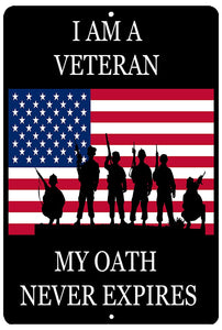 "An image of a black metal military sign from Nuddamakers that has an image of an American flag with the silhouettes of soldiers in front of it, and says ""I am a veteran, my oath never expires"" in white writing"
