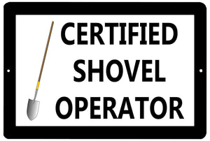 "black and white funny metal sign with a picture of a shovel that says ""certified shovel operator."""