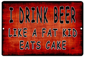 "orange funny drinking sign with black writing that says ""I drink beer like a fat kid eats cake."""