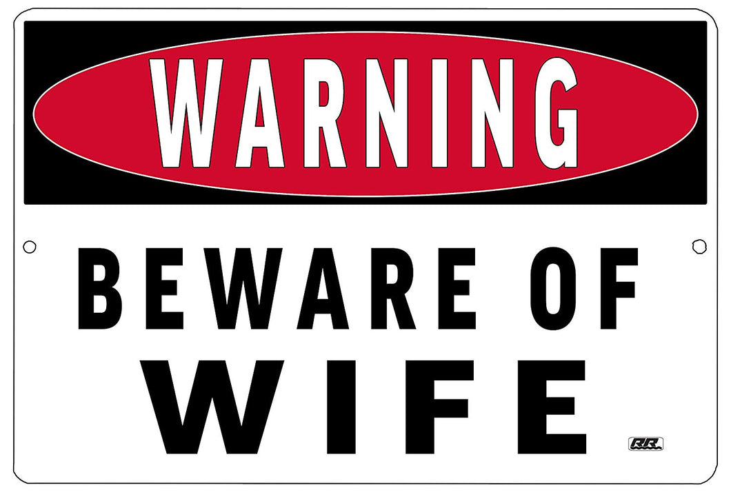 "An image of a white, funny metal sign from Nuddamakers that says ""Warning: Beware of Wife"" in black lettering"