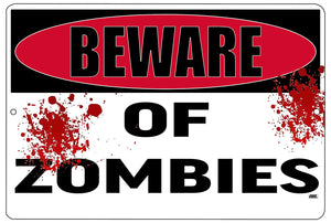 "black, white, and red funny metal sign with blood-like splatters that says ""beware of zombies."""