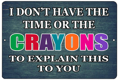 "An image of a funny metal sign with a blue background that says ""I don't have the time or the crayons to explain this to you"" in white and multi-colored writing from Nuddamakers."