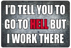 "An image of a gray funny metal sign from Nuddamakers that says ""I'd tell you to go to hell, but I work there"" in white and red lettering"