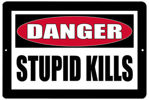 An image of a funny metal danger sign with a red danger warning and black and white lettering