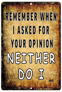 "An image of a yellow funny metal sign from Nuddamakers that says ""Remember when I asked for your opinion, neither do I"" in black and white writing."