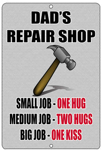 "funny metal sign with a picture of a hammer and red and black writing that says ""dad's repair shop. small job equals one hug, medium job equals two hugs, big job equals one kiss."""