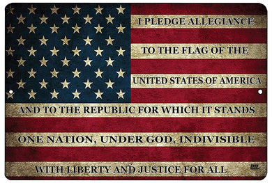 "An image of a military sign from Nuddamakers with an American flag background that says ""I pledge allegiance to the flag of the United States of America and to the republic for which it stands, one nation, under God, indivisible, with liberty and justice for all"" in black writing along the flag's stripes"