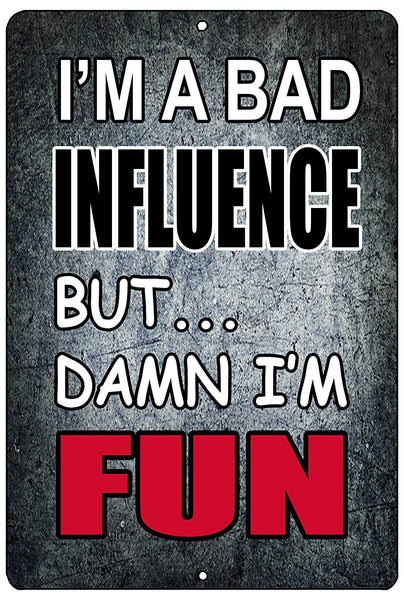 "An image of a gray funny metal sign from Nuddamakers that says ""I'm a bad influence but...damn I'm fun."""