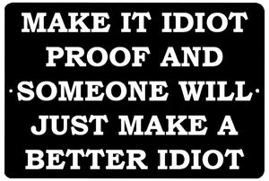 "An image of a black funny metal sign from Nuddamakers that says ""Make it idiot proof and someone will just make a better idiot"" in white lettering."