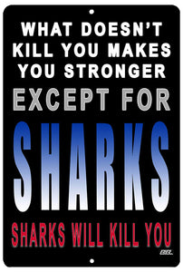 "black funny metal sign with white, blue, and red words that say ""what doesn't kill you makes you stronger. Except for sharks. Sharks will kill you."""
