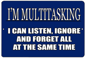 "An image of a blue funny metal sign from Nuddamakers that says ""I'm multitasking, I can listen, ignore, and forget all at the same time"" in white writing."