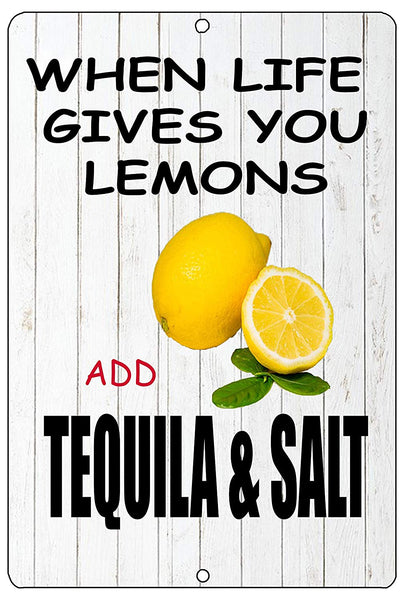 "An image of a funny drinking sign from Nuddamakers with a white, wood fence background that says ""when life gives you lemons, add tequila and salt"" with a picture of lemons in the middle and black writing"