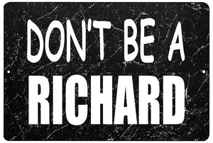 "An image of a funny metal sign with a black marble background from Nuddamakers that says ""Don't be a Richard"" in white lettering"