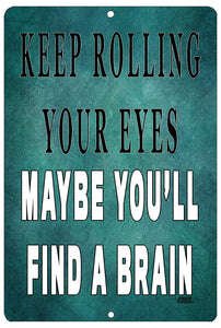 "An image of a blue funny metal sign from Nuddamakers that says ""keep rolling your eyes, maybe you'll find a brain"" in white and black lettering."