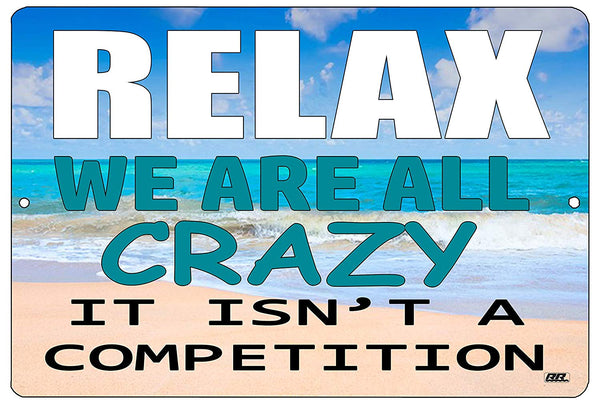 "An image of a funny metal sign from Nuddamakers with a beach scene background that says ""Relax, we are all crazy, it isn't a competition"" in white, blue, and black writing"