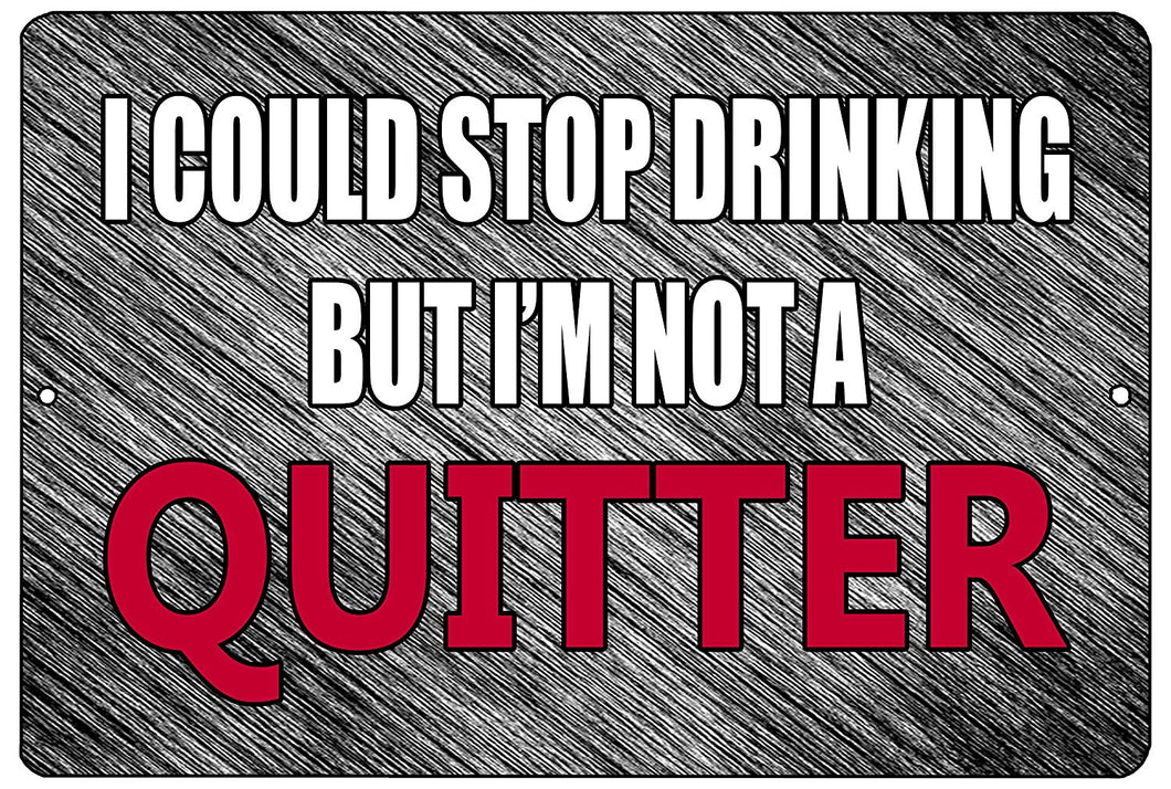 "An image of a gray funny drinking sign from Nuddamakers that says ""I could stop drinking, but I'm not a quitter"" in white and red writing"