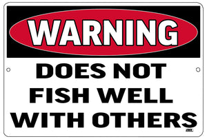 "white, black, and red funny metal warning sign that says ""warning, does not fish well with others."""