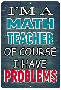 "An image of a blue funny metal sign from Nuddamakers that says ""I'm a math teacher, of course I have problems"" in white, blue, and red writing"
