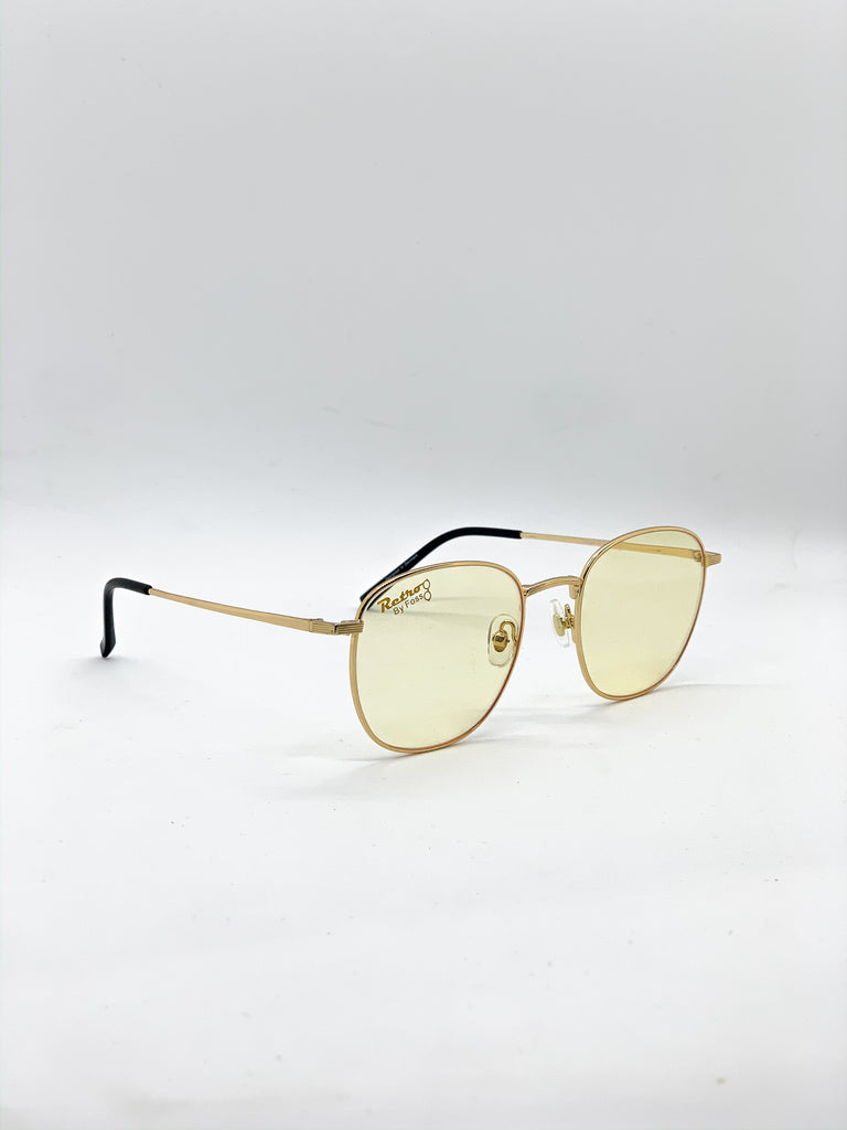 Light yellow retro glasses fom a side