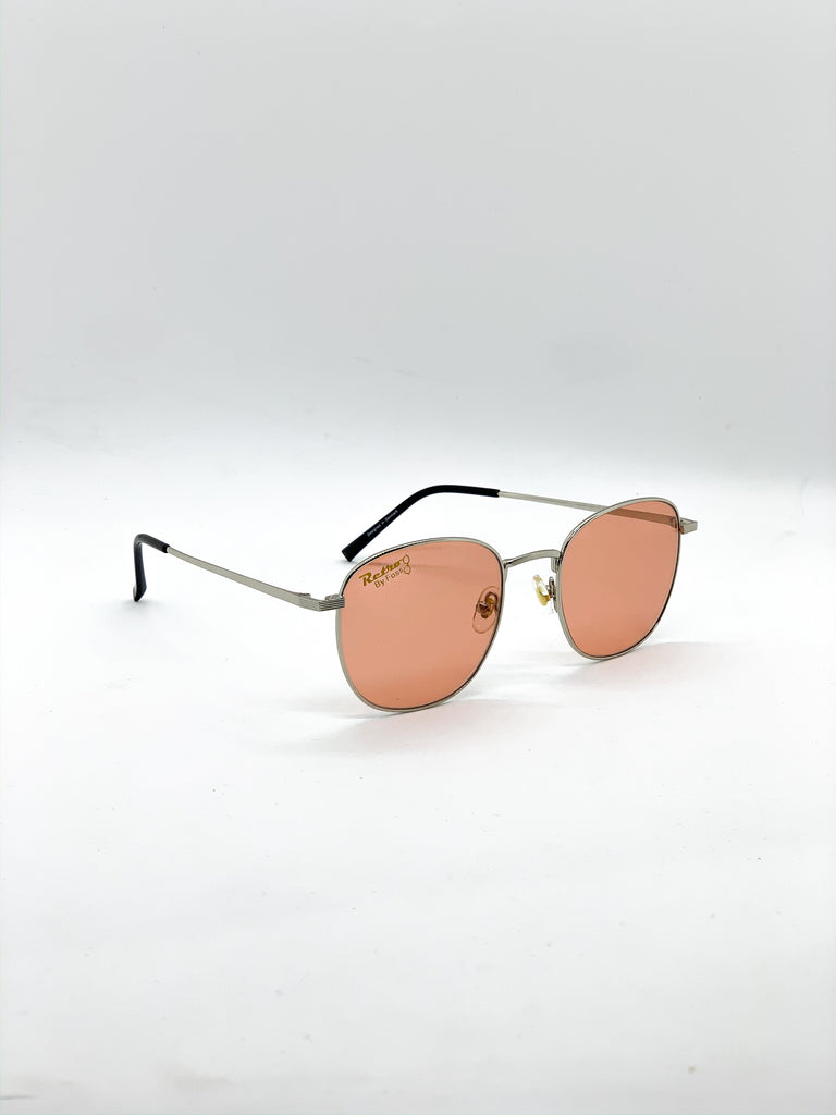 Light orange retro glasses fom a side
