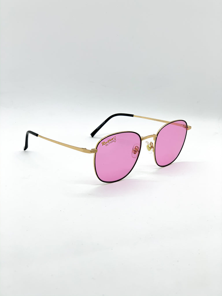 Pink retro glasses fom a side