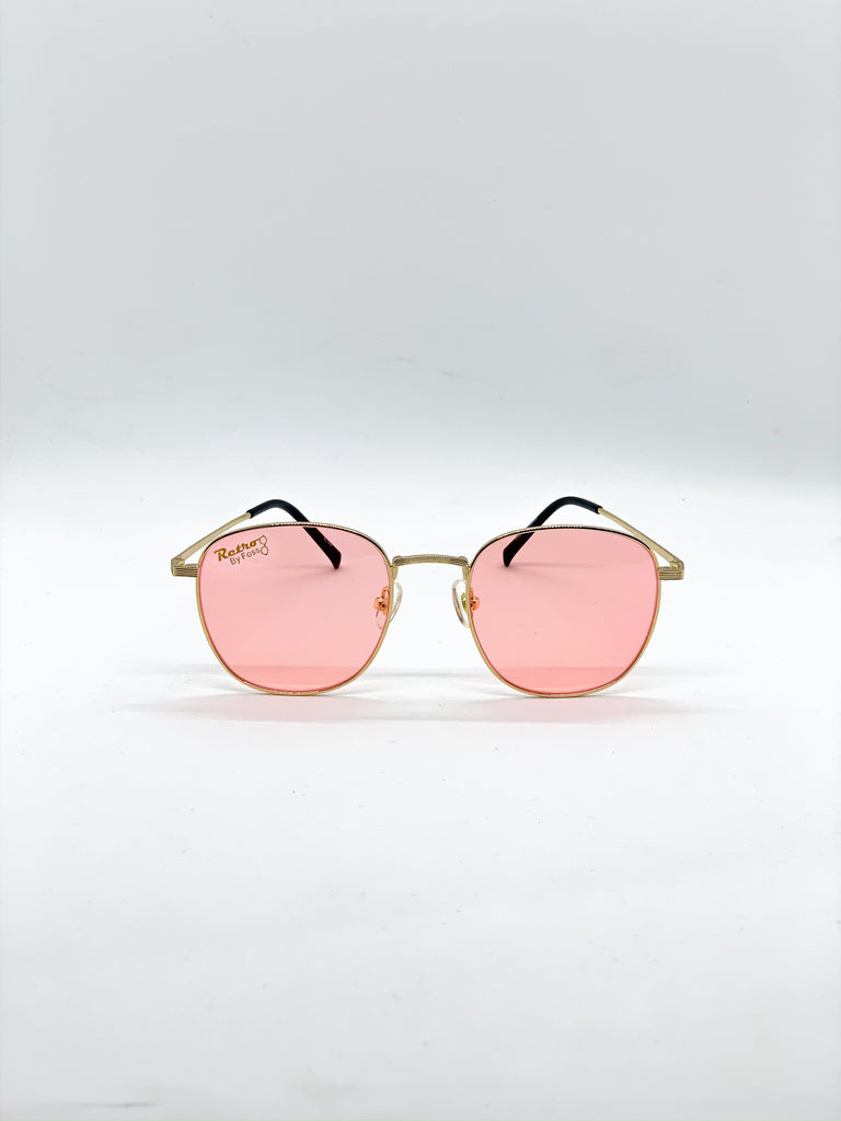 Pastel pink retro glasses fom the front