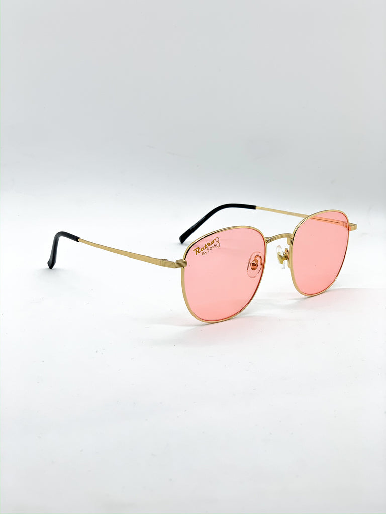 Pastel pink retro glasses fom a side