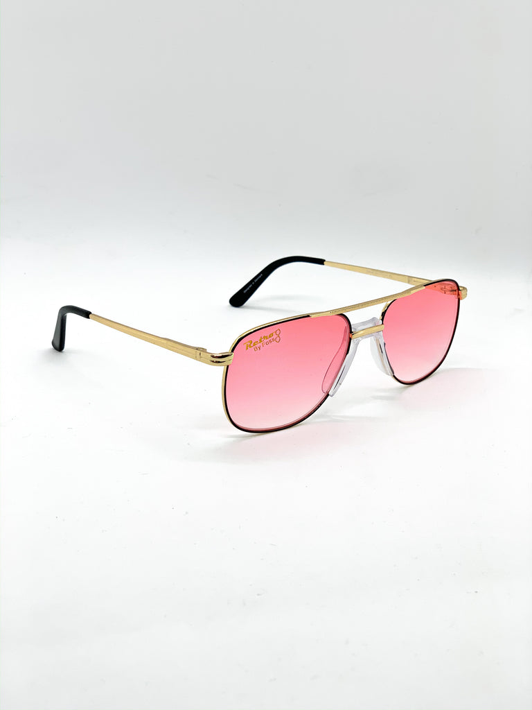 Faded pink retro glasses fom a side