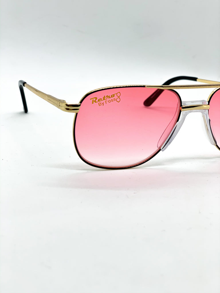 Faded pink retro glasses detail