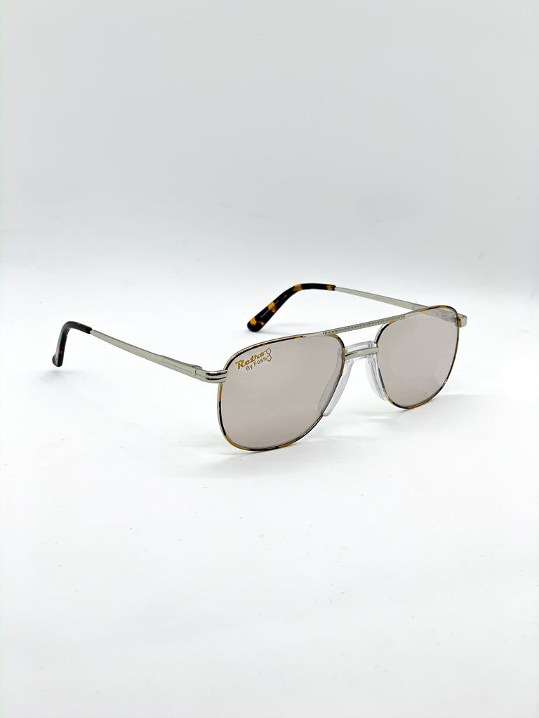 Grey retro glasses fom a side