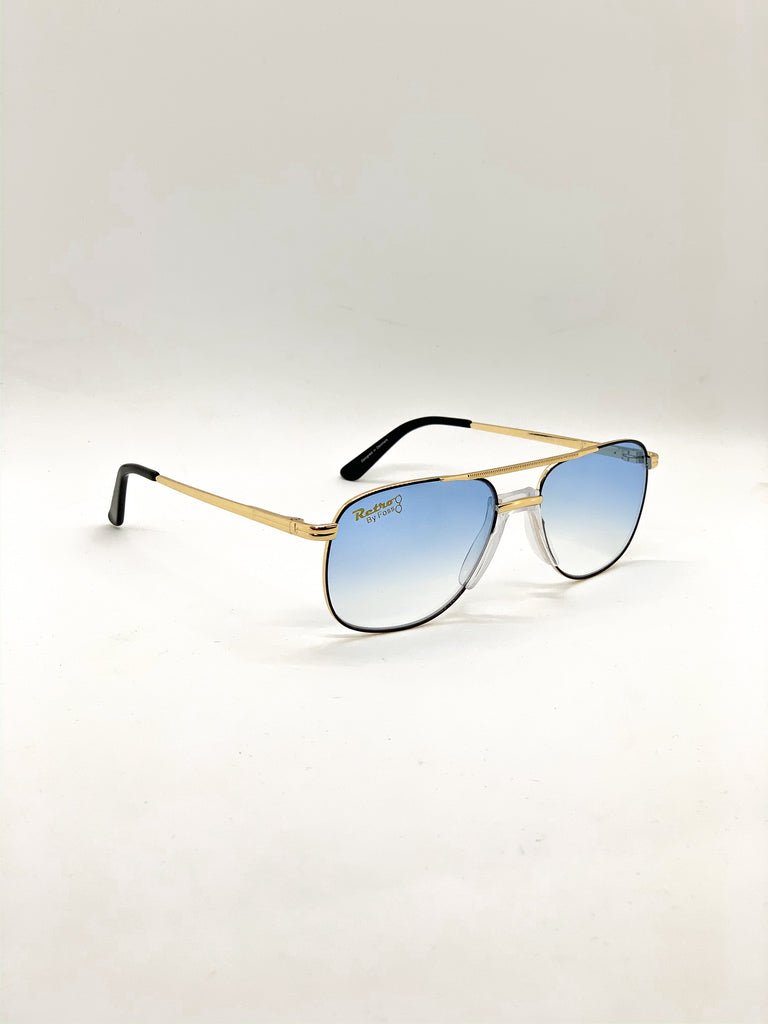 Faded light blue retro glasses fom a side