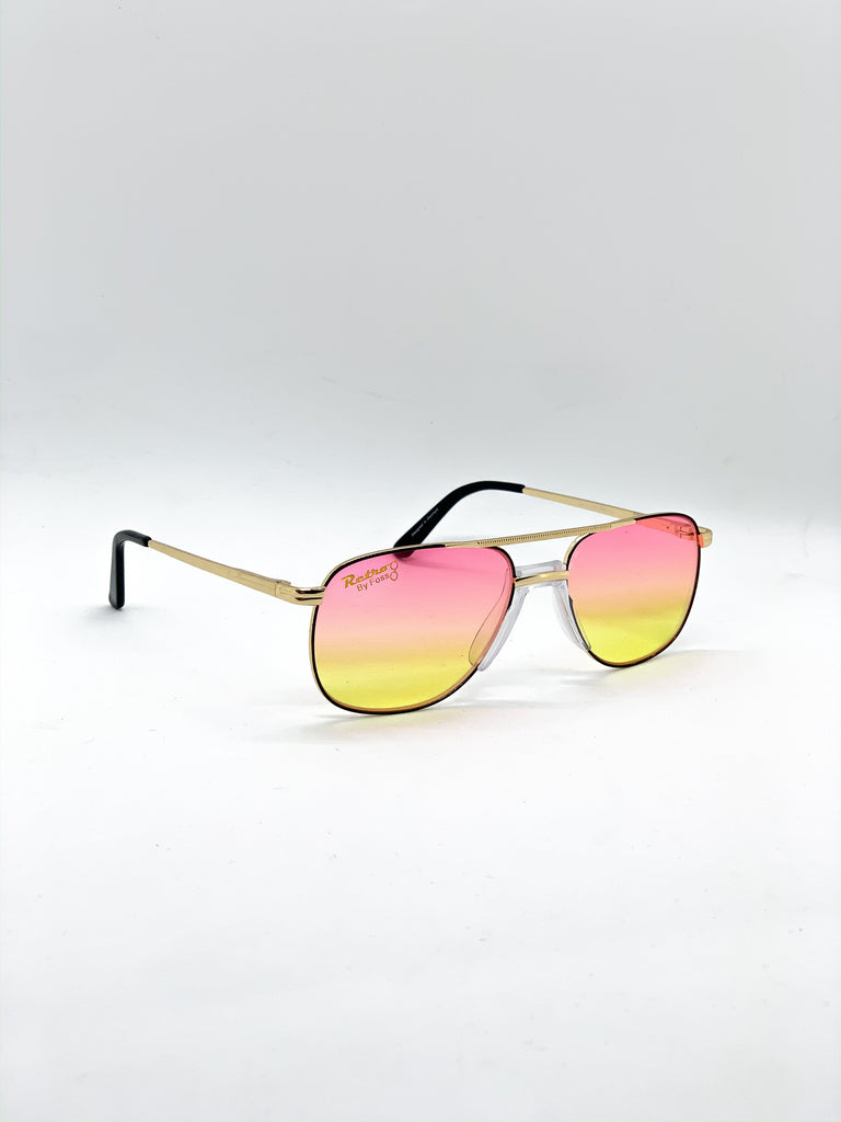 Pink & yellow retro glasses fom a side