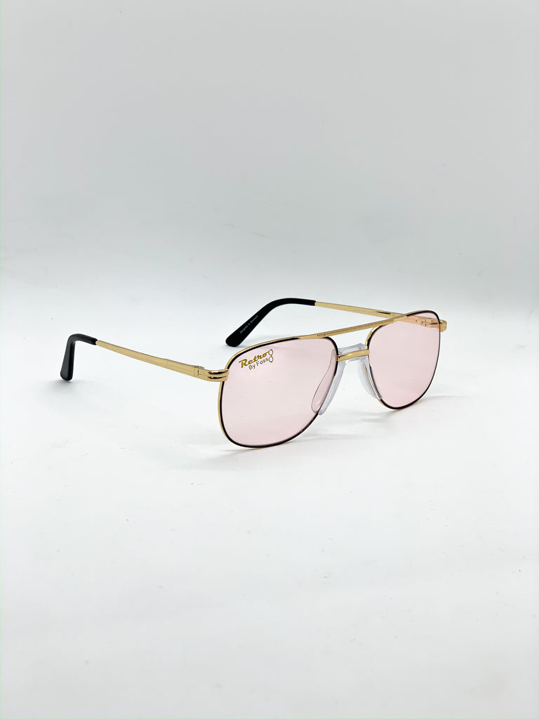 Light pink retro glasses fom a side