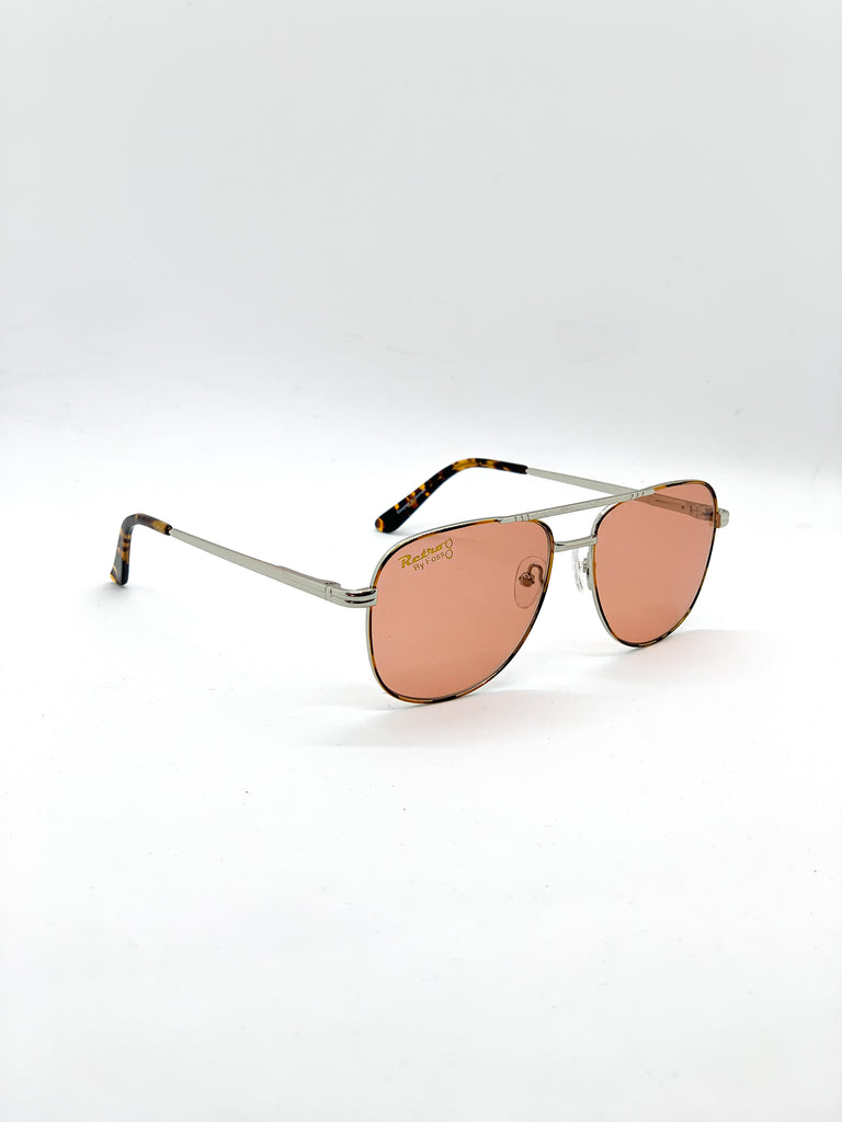 Orange retro glasses fom a side