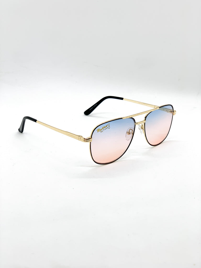 Light blue-pink retro glasses fom a side