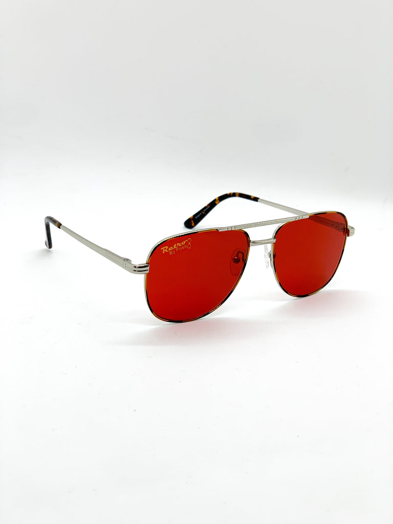 Dark red retro glasses fom a side