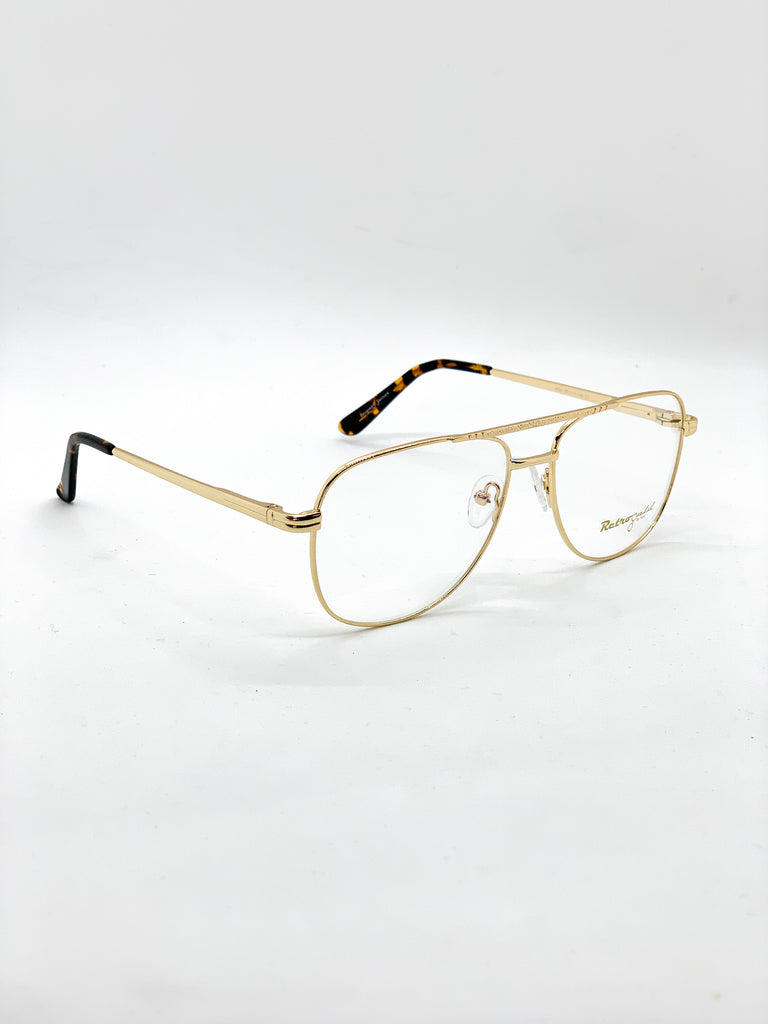 Gold retro glasses fom a side