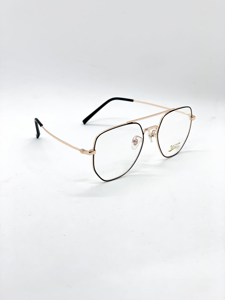 Gold and black retro glasses fom a side